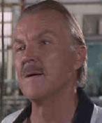 Milton Krest, spilt av Anthony Zerbe
