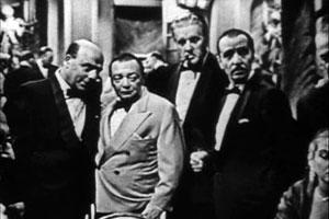 De slemme: Zoltan (Kurt Kach), Le Chiffre (Peter Lorre), Basil (Gene Roth) og Zuroff (ukjent)